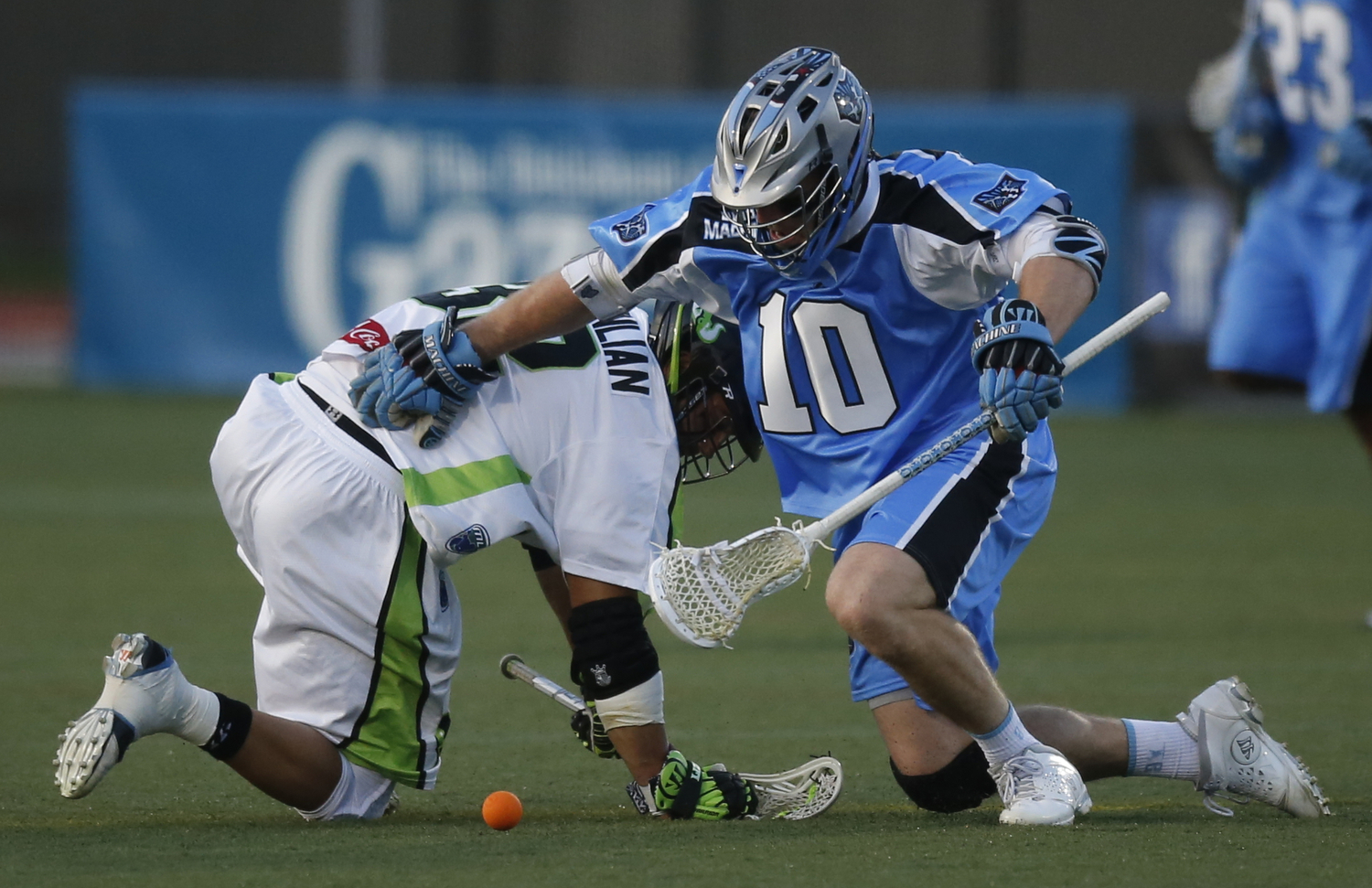 Ohio midfielder Eric O'Brien (10) takes a face-off against New York midfielder Greg Gurenlian (32) during the first quarter of the Major League Lacrosse match between the Ohio Machine and the New York Lizards at Selby Stadium on the campus of Ohio Wesleyan University in Delaware, Ohio, on Saturday, May 17, 2014. (Columbus Dispatch/Sam Greene