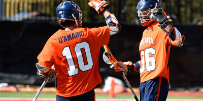SYRACUSE, NY - MARCH 12:  Zed Williams #36 of the Virginia Cavaliers reacts following his goal with teammate Mike D'Amario #10 against the Cornell Big Red during the first quarter at Schoellkopf Field on March 12, 2016 in Ithaca, New York.  Cornell won 14-10.  (Photo by Rich Barnes/Getty Images)