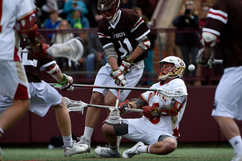 DENVER, CO - MAY 10: Brendan Caputo (41) of the Brown knocks Bryce Parietti (5) of the Denver to the turf during the first half of action. The University of Denver hosted Brown on Saturday, May 10, 2015. (Photo by AAron Ontiveroz/The Denver Post via Getty Images)