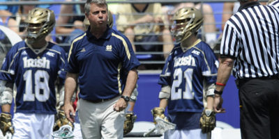 Notre Dame men's lacrosse coach Kevin Corrigan speaks to the referee in the first half of an NCAA championship lacrosse game against Duke on Monday, May 26, 2014, in Baltimore. (Gail Burton / Associated Press)