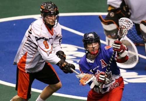 TORONTO, ON - JANUARY 23: Toronto, Canada - January 23 - In second quarter action, Toronto's Josh Sanderson is under pressure on the attack from Kevin Brownwell. The Toronto Rock take on the Buffalo bandits in their home opener in National Lacrosse League action at the Air Canada Centre. (Richard Lautens/Toronto Star via Getty Images)