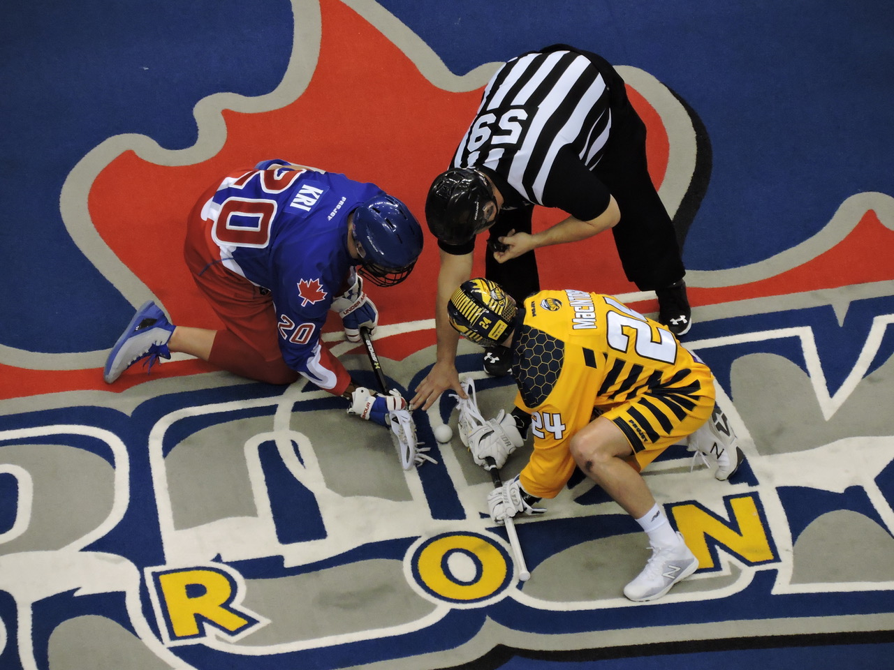 Bradley Kri and Jordan MacIntosh face-off as the Toronto Rock host the Georgia Swarm on February 17, 2017. (Photo credit: Anna Taylor)