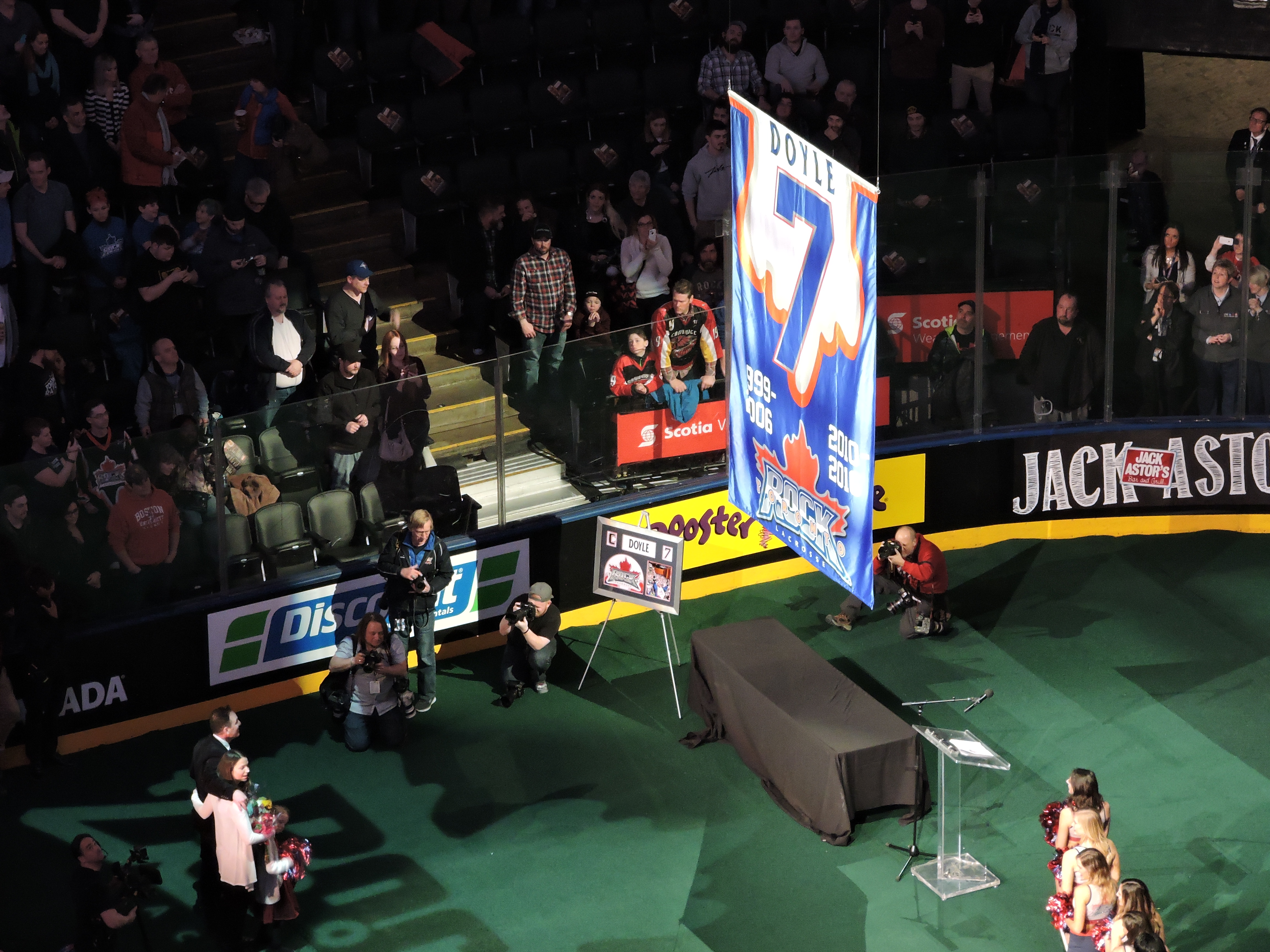 Colin Doyle watches his banner being raised to the ACC rafters on March 11, 2017. (Photo credit: Anna Taylor)
