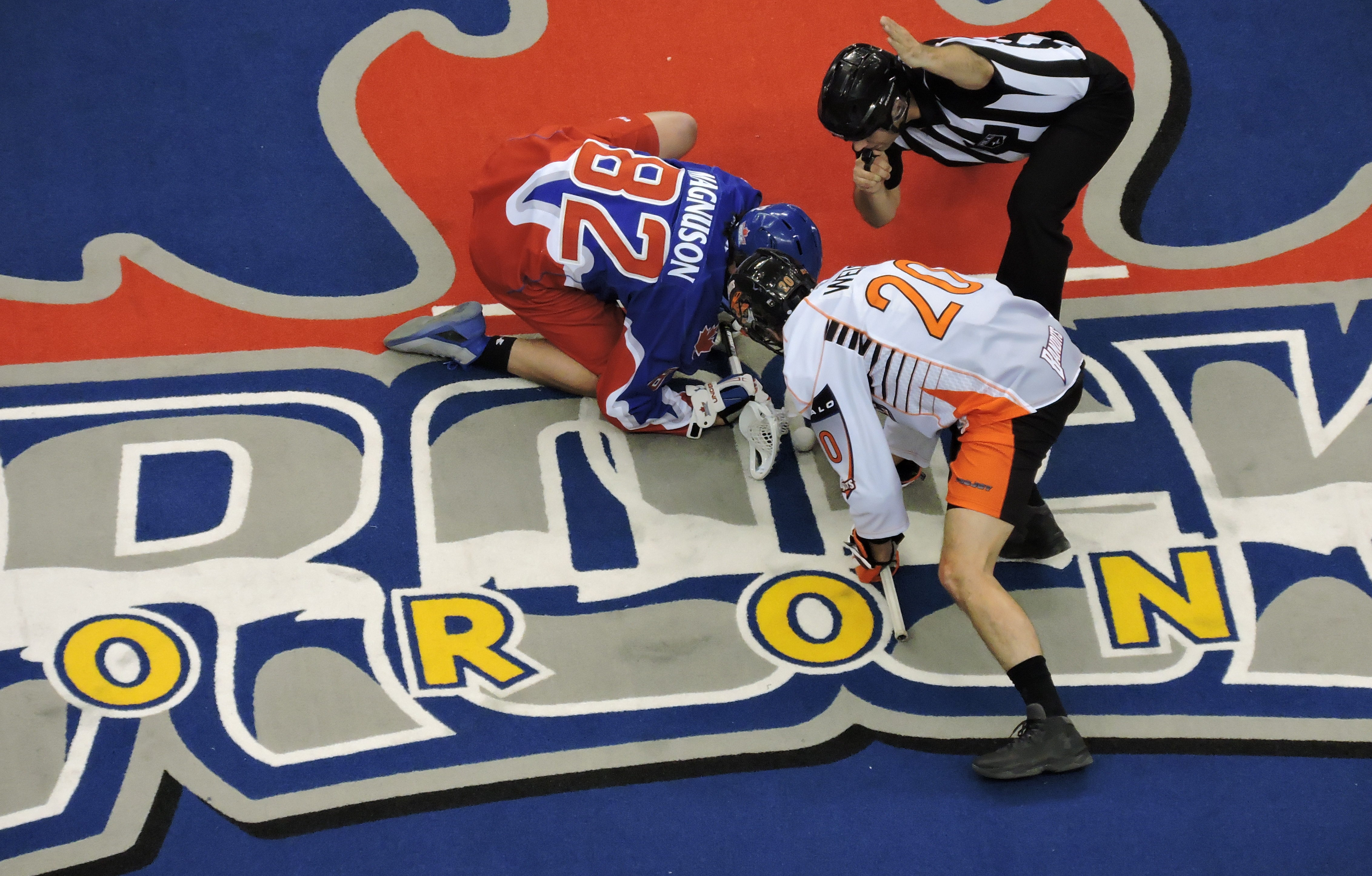 Jordan Magnuson and Nick Weiss face-off as the Toronto Rock host the Buffalo Bandits on April 14, 2017 at the Air Canada Centre. (Photo credit: Anna Taylor)