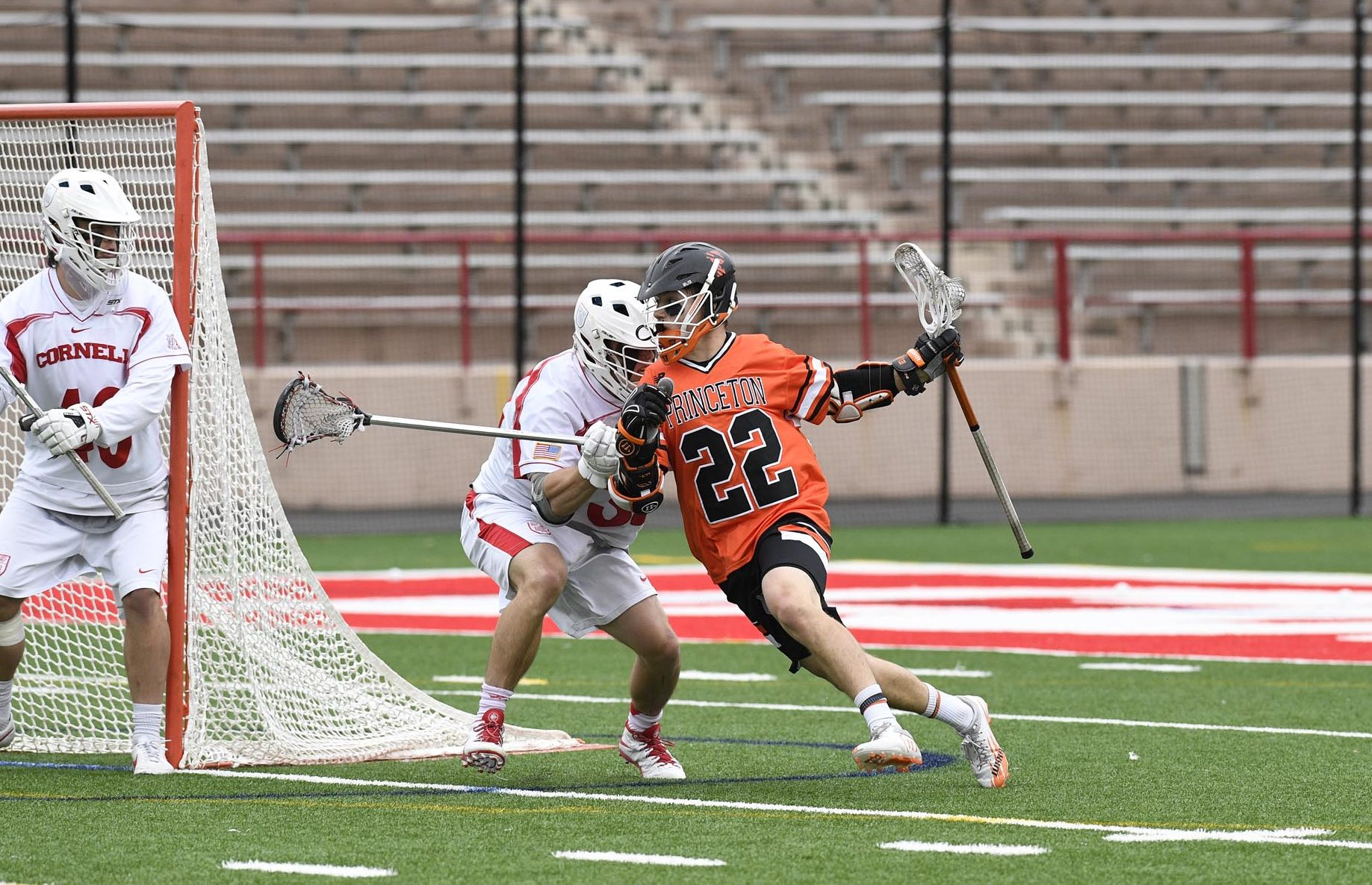 Michael Sowers of the Princeton Tigers fights off a Cornell Big Red defender on April 29, 2017. (Photo credit: Robert Goldstein)