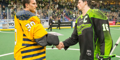 Mike Poulin of the Georgia Swarm shakes hands with captain Chris Corbeil of the Saskatchewan Rush. (Photo by Josh Schaefer/GetMyPhoto.ca)