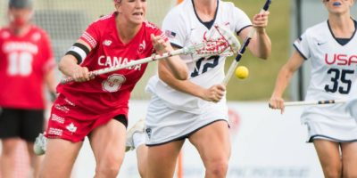 Canada's Katie Guy fights for possession with USA's Kayla Treanor at the 2017 FIL Rathbones Women's Lacrosse World Cup at Surrey Sports Park, Guilford, Surrey, UK, 15th July 2017. (Photo credit: Ady Kerry)