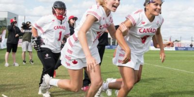 L-R; Allison Daley, Claire Mills, Danita Stroup run on to celebrate with their team at the end of the semi final win against Australia at the 2017 FIL Rathbones Women's Lacrosse World Cup at Surrey Sports Park, Guilford, Surrey, UK, 15th July 2017 (Credit Ady Kerry).