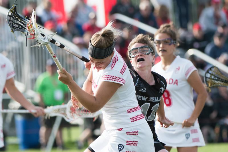 New Zealand's Jess Page tries to disposses Canada's Kay Morissette at the 2017 FIL Rathbones Women's Lacrosse World Cup at Surrey Sports Park, Guilford, Surrey, UK, 15th July 2017 (Credit Ady Kerry).