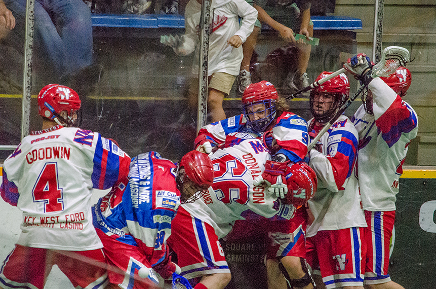 Shawn Evans and Mark Steenhuis mix it up with the New Westminster Salmonbellies in the 2017 Mann Cup. (Photo credit: Kendall Taylor)