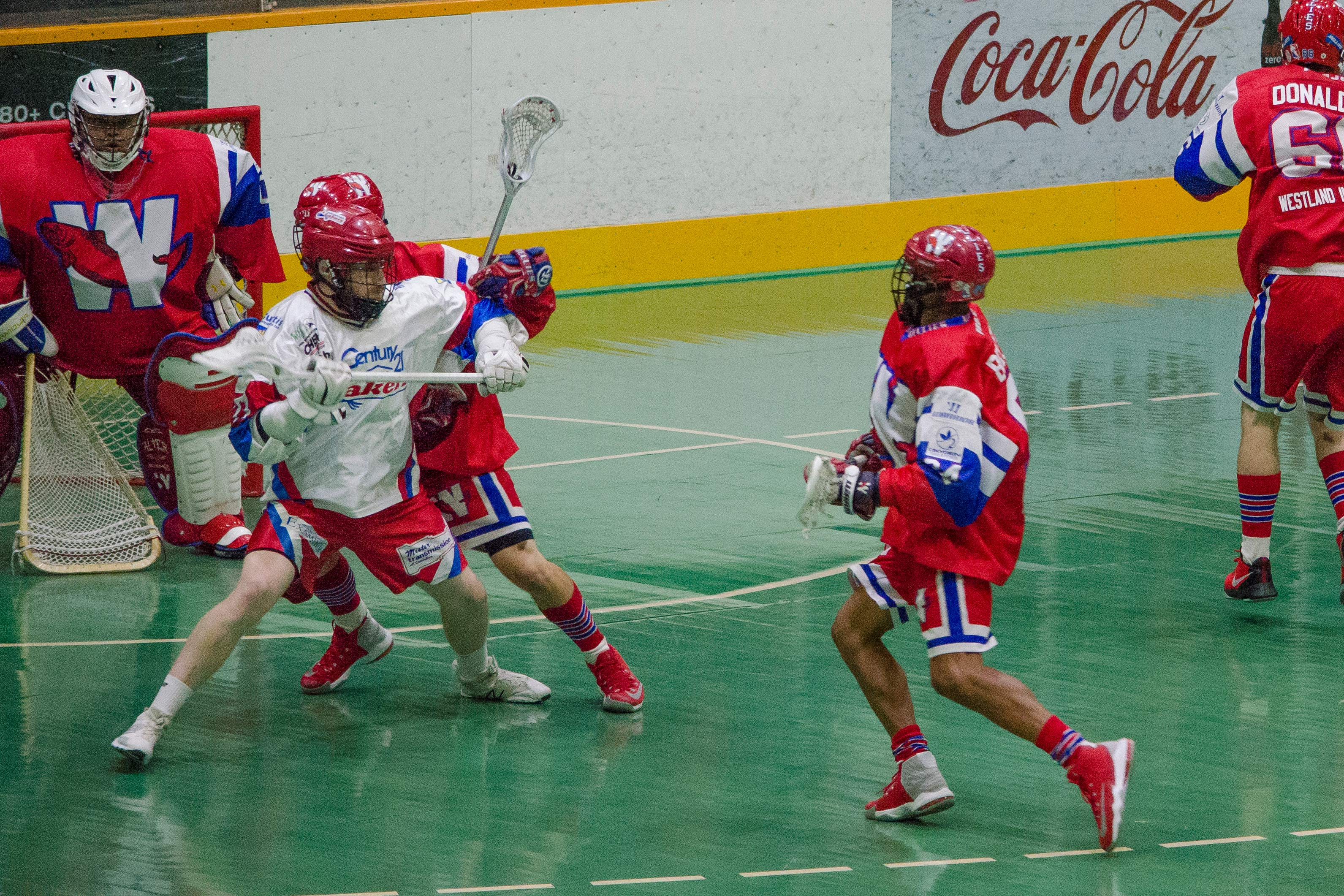 Curtis Dickson of the Peterborough Lakers fights off a New Westminster Salmonbellies defender during the 2017 Mann Cup. (Photo credit: Kendall Taylor)