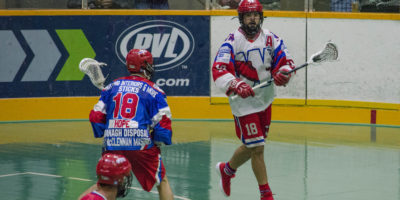Logan Schuss of the New Westminster Salmonbellies is guarded by Robert Hope of the Peterborough Lakers during the 2017 Mann Cup. (Photo credit: Kendall Taylor)