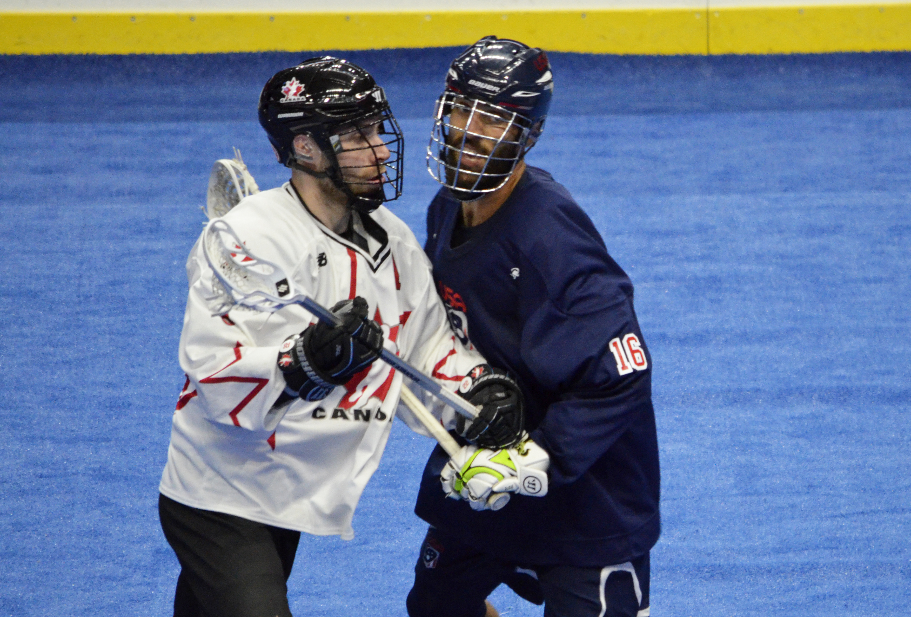 Paul Rabil of Team USA tries to get around Team Canada defender Ryan Dilks during the 2017 Heritage Cup in Hamilton, Ont. (Photo credit: Anna Taylor)